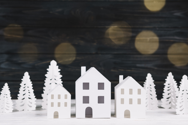 handmade-paper-houses-and-fir-trees_23-2147983663